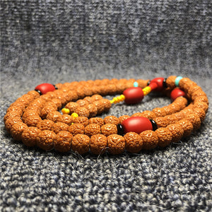 108 Rudraksha japa mala with red sherpa beads