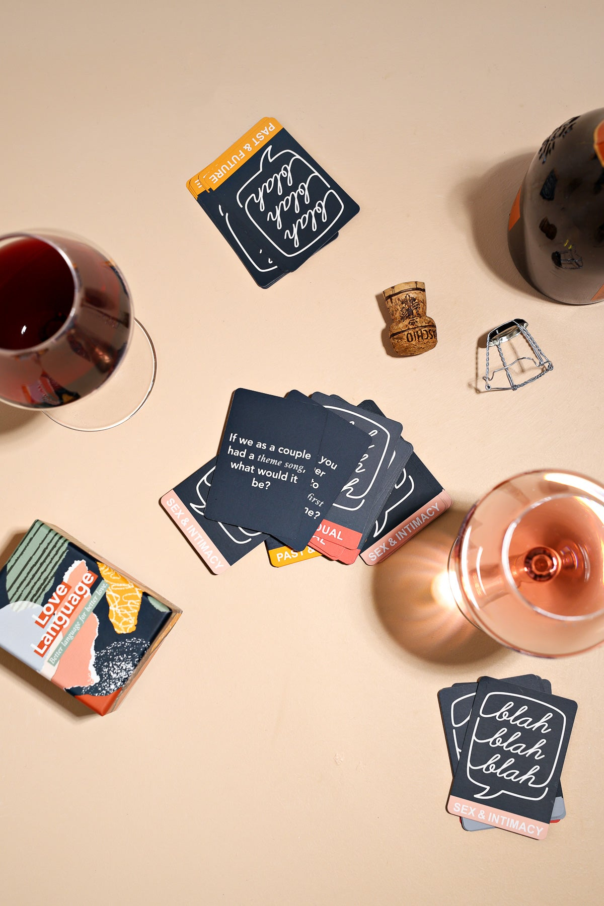 Wine glasses and Love Language Couples, the best conversation starter and icebreaker game for date night and bonding