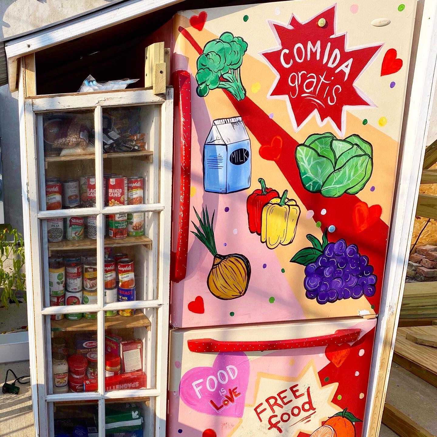 "Hand-painted ""Honey Love"" Fridge in Chicago's Avondale neighborhood filled with fresh produce."