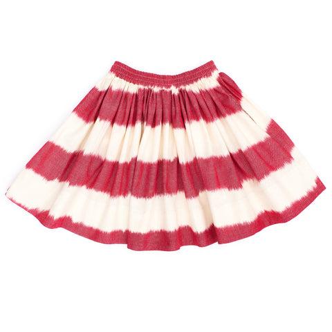Midinette skirt in raspberry red ikat. Wide raspberry red stripes and gathered, elasticated waist.
