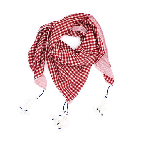 Wrapped loulou scarf in red and white handwoven cotton-silk gingham and handwoven cotton with micro red checks. Long cream tiered tassels at each corner.