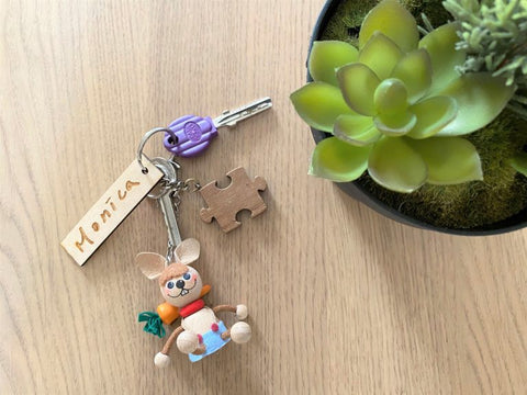 Assemble the engraved signature charm with a keyring