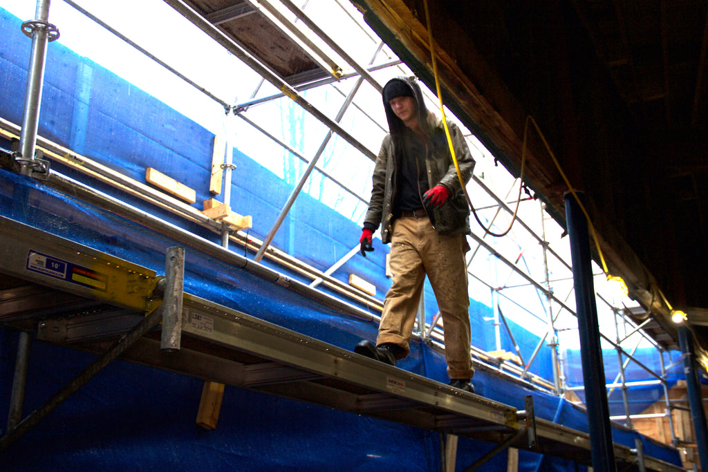 Dan walking on the scaffolding in his Rigger work boots