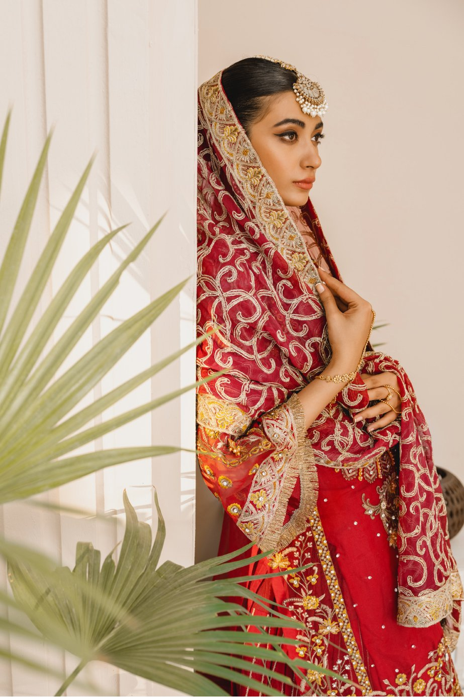Formal Lehenga - Red & Red (MX-10) - Mashq Premium | A female model wearing a stunning and beautiful Formal Lehenga and posing for the Photoshoot of Mashq's Formal Wear Collection