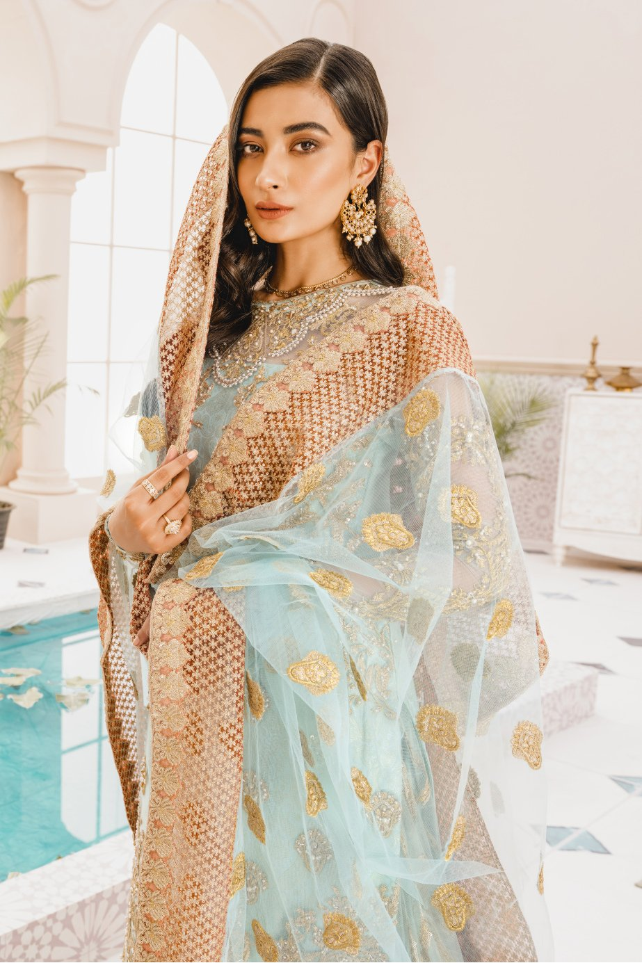 Formal Lehenga - Blue Age (MX-02) - Mashq Premium | A female model wearing a stunning and beautiful Formal Lehenga and posing for the Photoshoot of Mashq's Formal Wear Collection