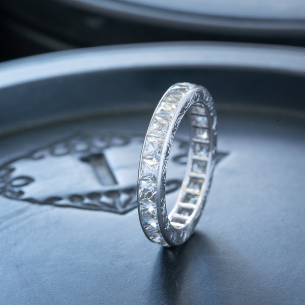 HAND ENGRAVED PLATINUM AND 4.0CTS. FRENCH CUT DIAMOND ETERNITY RING