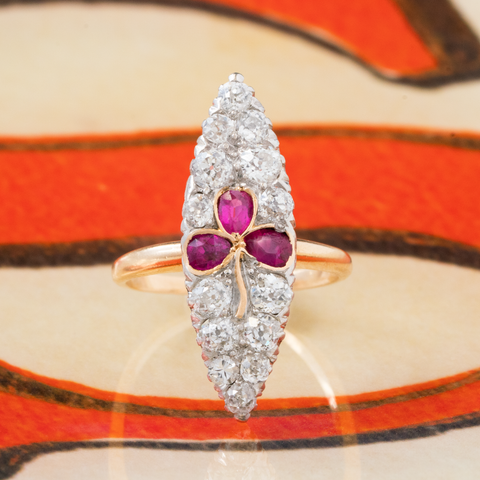 VICTORIAN 18K YELLOW GOLD, SILVER AND 1.15CTS. OLD EUROPEAN CUT DIAMONDS AND NATURAL RUBIES TREFOIL NAVETTE RING c.1880s