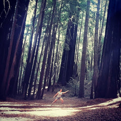 Emily Drysdale from Bliss Calm Qigong practicing Qigong in the Californian Redwoods