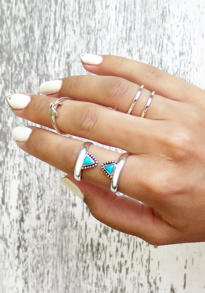 Double band sterling silver ring with two triangle turquoise stones facing eachother by Lakiki Jewellery