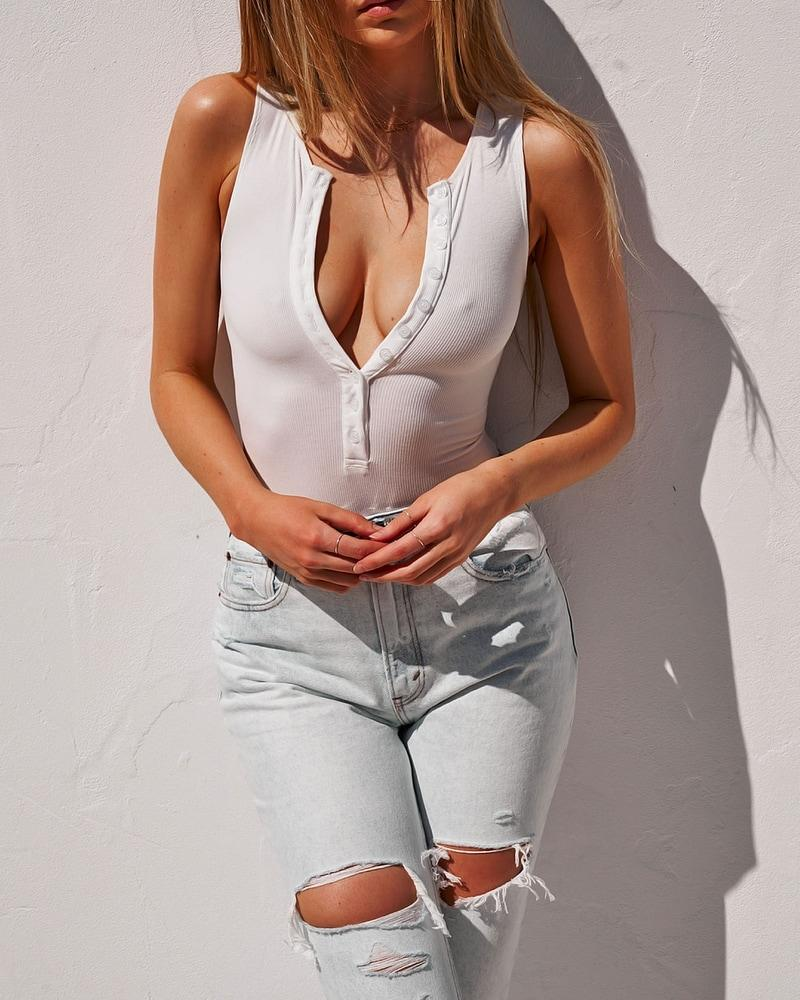 white crew neck button down bodysuit