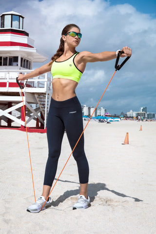 Image of woman using resistant bands in her Energy Pants