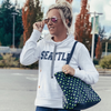 Brandelyn, wife of Joe Tafoya- Seattle Seahawks football in a Lady 12 white hoodie sweatshirt-football- apparel -clothing