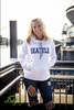 Brandelyn, wife of Joe Tafoya- Seattle Seahawks football in a Lady 12 white hoodie sweatshirt