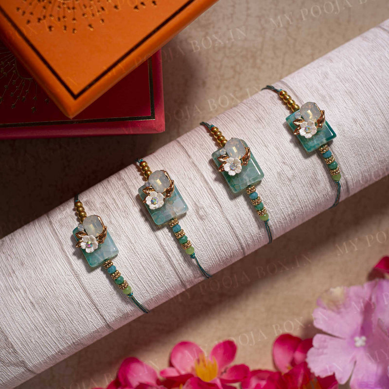 Teal Blue Floral Stone Rakhi (Set of 4)