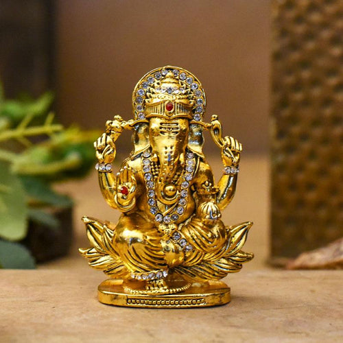 Golden Lord Ganesha Statue On Lotus