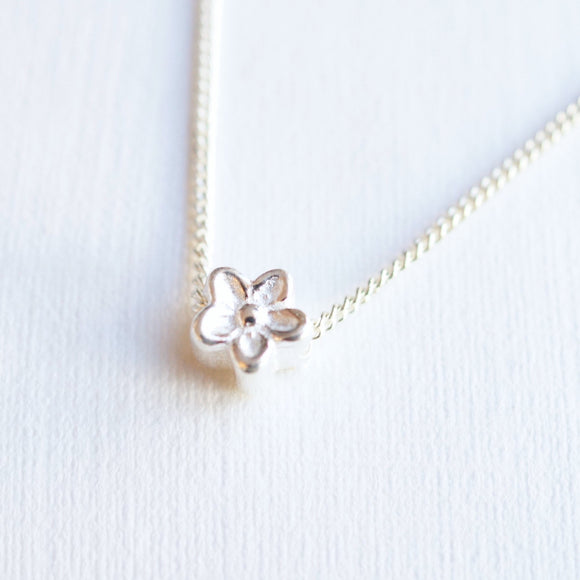 tiny flower pendant silver