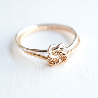 gold and silver knot ring mixed metal