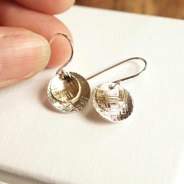 gold and silver dangle disc earrings