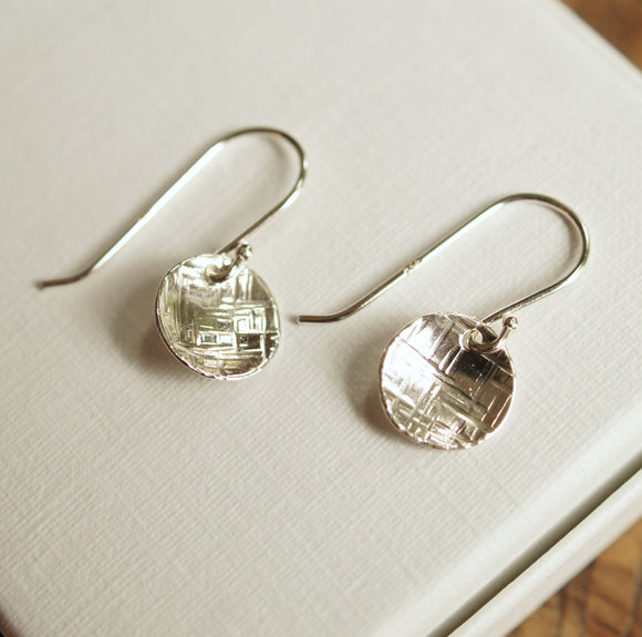 hammered silver earrings on French hooks