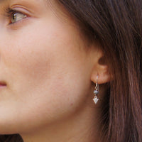 tiny gem earring on model Alex