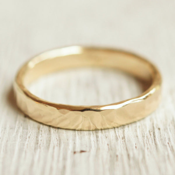 Modern hammered gold wedding band