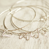 silver bangles for stacking with heart charms