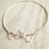 sterling silver stacking bangle with heart charms