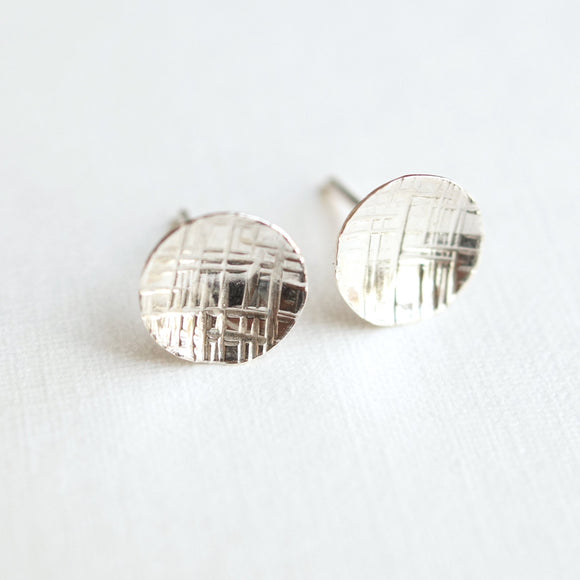 small and simple round silver disc earrings hammered