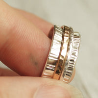 spinner ring mixed metal with a gold filled and silver spinner band