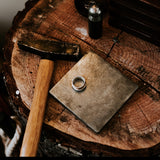 jewellery studio bench stump photo with hammer and anvil