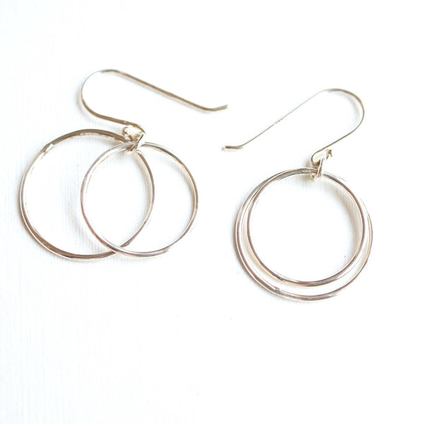 thin silver hoop earrings on French hooks