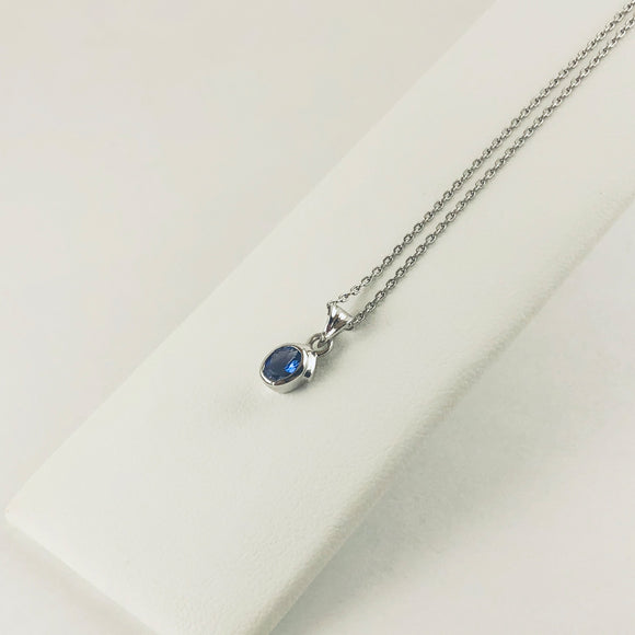 Stylish Oval Tanzanite Stone Encased in Silver Pendant