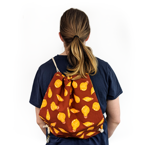 brighten your world backpack