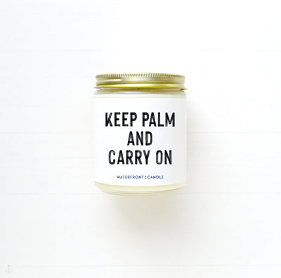 The Keep Palm and Carry On Coconut Lime scented 9 oz natural soy wax candle by Waterfront Candle