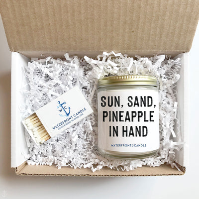 The Sun, Sand, Pineapple in Hand Pineapple scented 9 oz natural soy wax candle gift box by Waterfront Candle