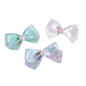 A trio of spring floral bow hair clips for girls