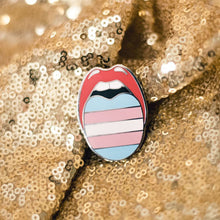 Load image into Gallery viewer, Trans Pride Pin featuring the transgender pride colors like the transgender pride flag! The enamel pin features a unique design in the shape of a mouth with a tongue sticking out. Fiercely designed and available only from Queen On The Scene Shop!