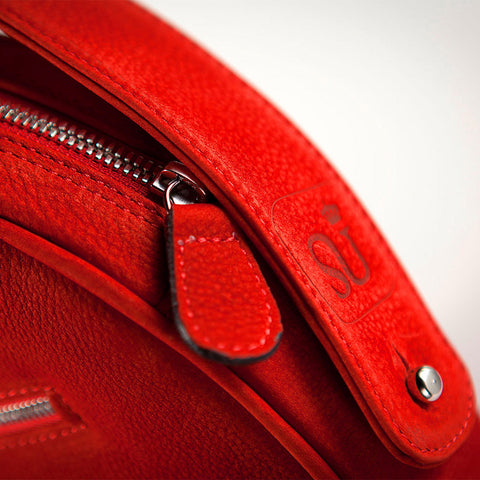 Bags-by-Sumageza-SU-stands-for-excellent-craftsmanship-shown-here-on-the-round-ladies-handbag-made-of-red-nubuck-leather