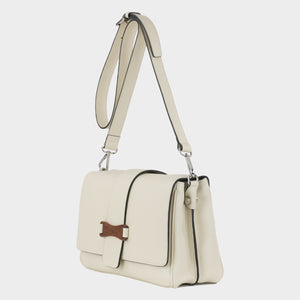Bags-by-SUMAGEZA-SU-Bubinga - ladies bag-beige-calfskin-long handle, front-13, turned 45 degrees to the left, beige leather with black rim and Bubinga decorative element complemented