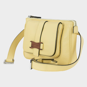 Bags-by-SUMAGEZA-SU-Le-Double-Crossbody-lemon-yellow-calf leather, front view-12, bag turned 45 degrees to the left, yellow leather contrasted by a dark rim.