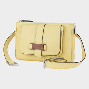 Bags-by-SUMAGEZA-SU-Le-Double-Crossbody-lemon yellow-calf leather, front view-13, turned about 15 degrees to the left, Bubinga wood decor element on the front.