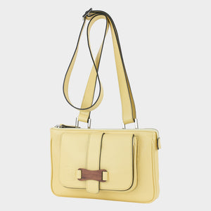 Bags-by-SUMAGEZA-SU-Le-Double-Crossbody-lemon yellow-calf leather, front view-16, bag turned 30 degrees to the left, offers a larger pocket with zipper and in front a smaller one with magnetic closure.