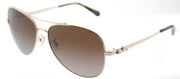 Coach HC 7074 9310T5 Aviator Metal Gold Sunglasses with Brown Gradient Polarized Lens
