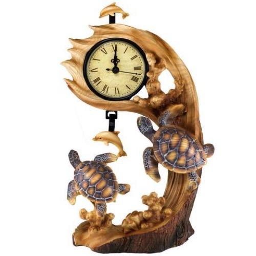 A unique faux wood Sea Turtles Clock is a great addition to your beach house or nautical themed décor. The detailed finish beautifully mimics wood grains and bark like texture around the base. With looks as if it has ben carved out of. area log and a dolphin pendulum that swings to mark the time the esthetic it adds is unique in personality.