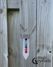 Load and play video in Gallery viewer, 7 Chakra Single Point Rose Quartz Pendant Necklace - Magic Crystals - 7 Chakra Pendants