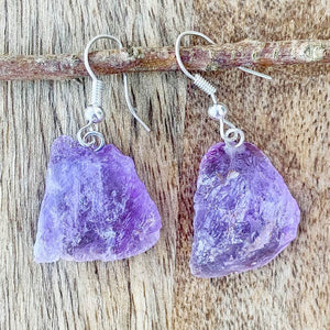Shop for beautiful Natural Raw Amethyst Dangling Earrings - Raw Amethyst crystal Jewelry at Magiccrystals.com . Magic Crystals have an excellent choice for women. available with FREE SHIPPING and in gold. Find an Amethyst Earring or Genuine Amethyst Earring when you shop at Magic Crystals. February birthstone.