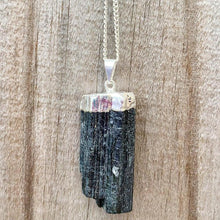 Load image into Gallery viewer, Check out our Raw Black Tourmaline Crystal Pendant Silver Necklace. The Best Quality Handmade Healing Crystal Gemstones for Protection. This is a Great Stone to Keep you grounded and Align your Root Chakra. Black Tourmaline Also Aids in the Removal of Negative Energies Within a Person or a Space. Magic Crystal Free Shipping Available.