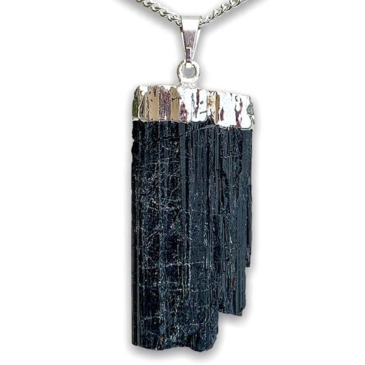 Check out our Raw Black Tourmaline Crystal Pendant Silver Necklace. The Best Quality Handmade Healing Crystal Gemstones for Protection. This is a Great Stone to Keep you grounded and Align your Root Chakra. Black Tourmaline Also Aids in the Removal of Negative Energies Within a Person or a Space. Magic Crystal Free Shipping Available.