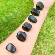 Load image into Gallery viewer, Looking for Black Obsidian? Enjoy FREE SHIPPING at Magic Crystals when you are looking for Black Obsidian TUMBLED MEDIUM - Tumbled Black Obsidian - Grounding Protection - Root Chakra - Base Chakra for Energy Healing. Black Obsidian is a very protective stone and is excellent for removing negativity.