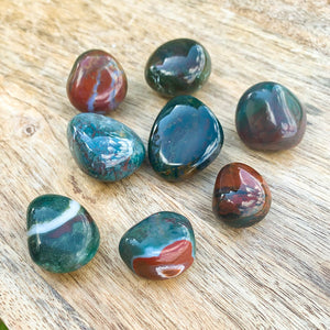 Buy Bloodstone Tumbled Stones | Bloodstone Polished Gemstones | Bulk Crystals at Magic Crystals. Bloodstone or Sanguinaria is an uplifting and protective. It facilitates clarity decision and boosts energy. FREE SHIPPING available.